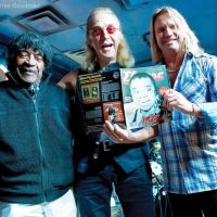 Eddie Kirkland with Roger Earl and Charlie of Foghat | Photographed by Arnie Goodman