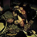 frontman John Robinson tackles guitarist Ian McDonald at CMJ