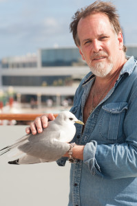 Robert Reynolds with a feathered friend. Photo by Laura Carbone