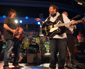 Wayne Toups (left) joins Raul Malo at the Mavericks' performance on the Sandy Beaches Cruise. Photo by Laura Carbone