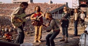 Drummond (center) performing with Crosby, Stills & Nash